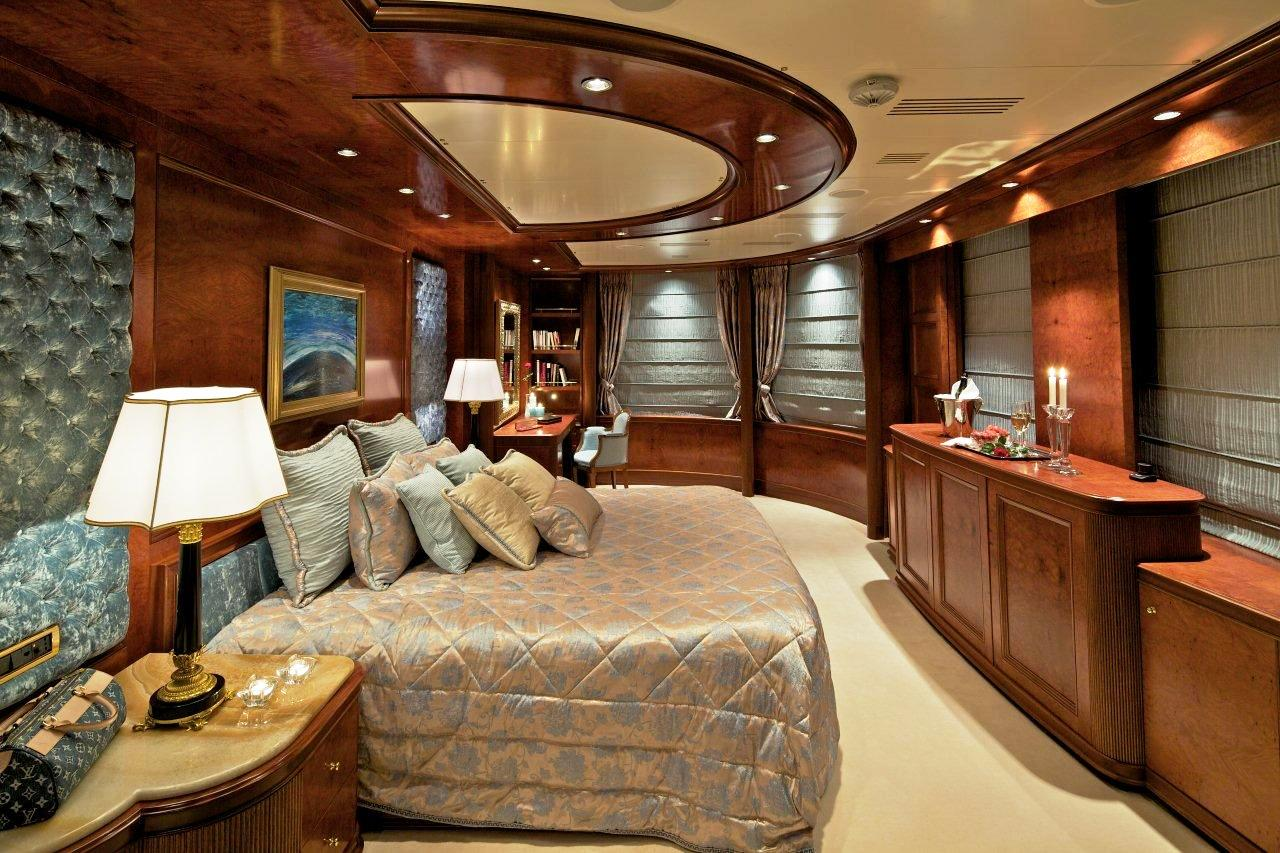Master stateroom aboard luxury yacht OMEGA