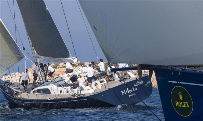 Sailing yacht Nikata ahead of her competitor's bow - Photo by RolexCarlo Borlenghi