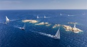 The Swan fleet attack a challenging coastal course around the islands of the Maddalena Archipelago - Photo by RolexCarlo Borlenghi
