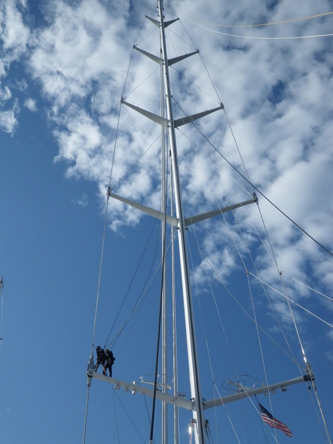 Marine Results personnel work on the gigantic M5 sailing yacht mast.