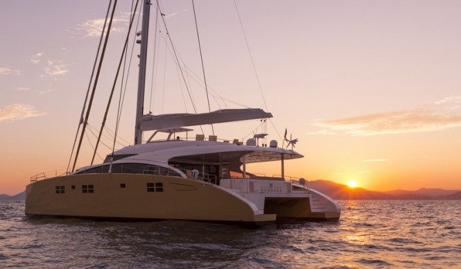 Splendid catamaran yacht HOUBARA at sunset