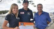 Emma Milne and Steve Sammes present the 2012 Expo donation to Jared Clark from the Westpac Surf Life Saver Helicopter Rescue Service
