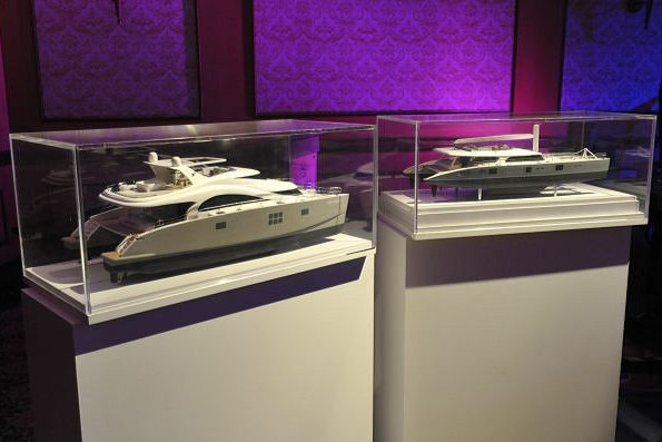 Models of luxury catamaran yachts by Sunreef on display during the event