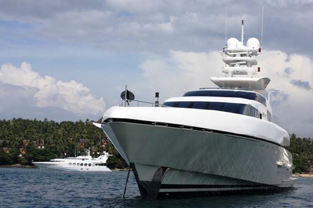 PHUKET, THAILAND Superyachts moored in Surin Bay