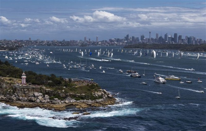 Bird's eye view of start of the 2012 Rolex Sydney Hobart, with cityscape in background - Photo by Rolex  Carlo Borlenghi