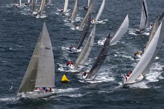 Fleet leaving Sydney Harbour after start of 68th Rolex Sydney Hobart - Photo by Rolex - Carlo Borlenghi