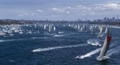 Sailing yacht Wild Oats XI leads fleet out of harbour after start of 68th Rolex Sydney Hobart