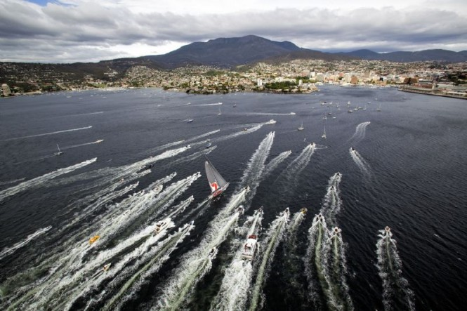 The first yacht to finish receives a royal welcome in Hobart - Photo credit Rolex Daniel Forster