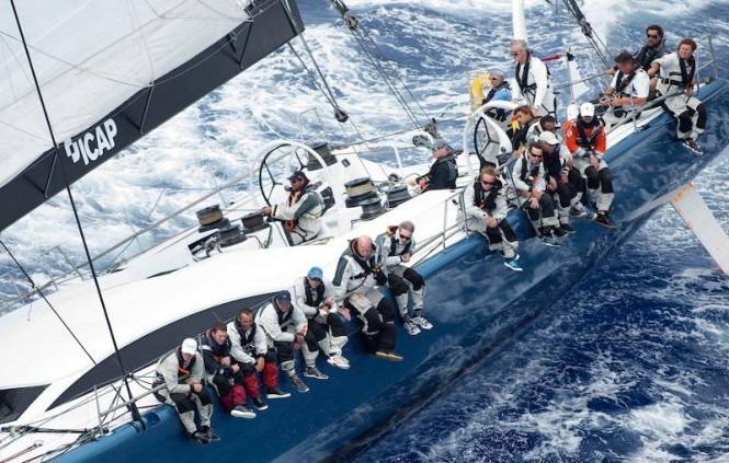 Mike Slade at the helm of his Farr 100, ICAP Leopard  Credit: Ocean Images/Richard Langdon