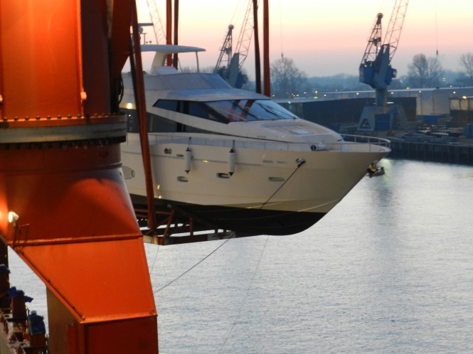 Monte Fino 76 yacht being unloaded from the hold into the River Rhine