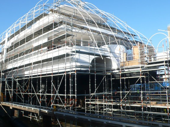 Scaffolding around White Rabbit Echo yacht, in preparation for work