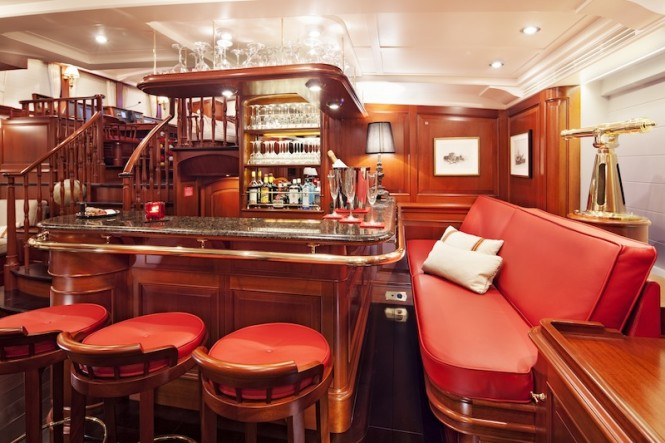 Kamaxitha superyacht - lower salon bar - Photo by Cory Silken