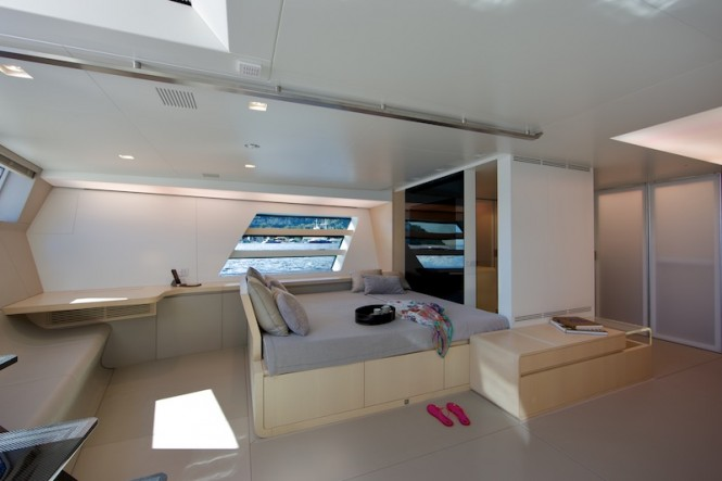 Wally yacht Better Place - Owners suite port side with lounge and TV  area - Photo by Toni Meneguzzo
