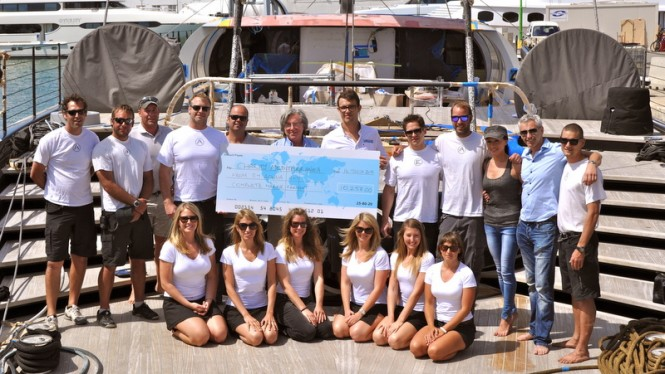 Crew of sailing yacht Aglaia with cheque for 12,258€ for charity 'Mediterranea'
