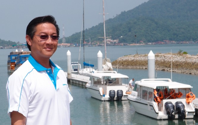 James Khoo General Manager PMSB with Gulf Craft yachts in the background