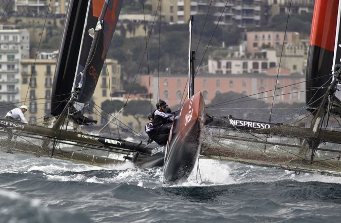 Oracle Team USA and Emirates Team New Zealand in action at ACWS Naples 2012 © FrancescoFerri/Seaway/Nespresso