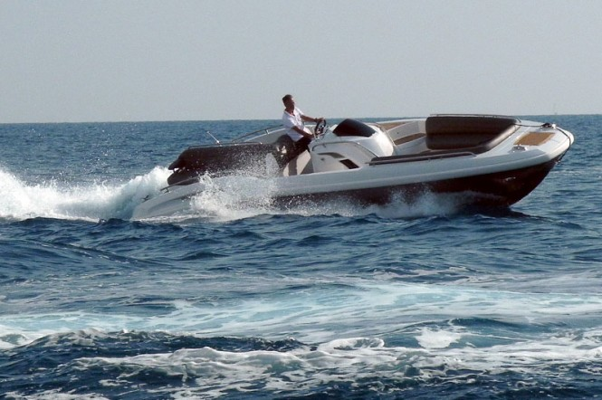 HTM 825 Open yacht tender to Stella Maris Yacht at full speed