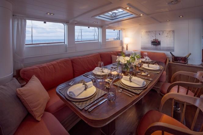 Royal Huisman Sailing Yacht Pumula - main deckhouse dining - Photo by Cory Silken