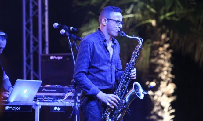 The saxophonist takes centre stage at the beach club party