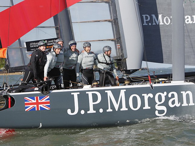 Ben and his team on J.P.Morgan BAR celebrate their fabulous record-breaking achievement right after crossing the line in today's J.P. Morgan Asset Management Round the Island Race. Photo: Patrick Eden