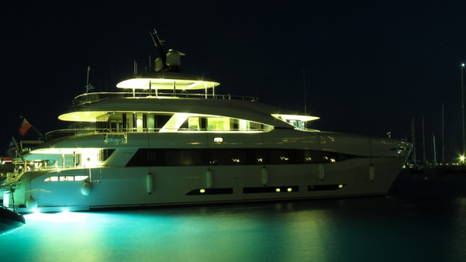 Quaranta Yacht by night with under water lights