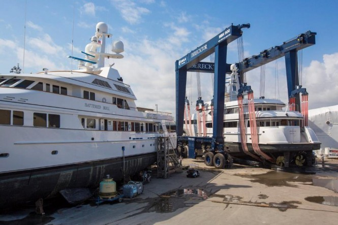 170ft Feadship Yacht Dream being maneuvered past 171ft Feadship superyacht Battered Bull at Derecktor