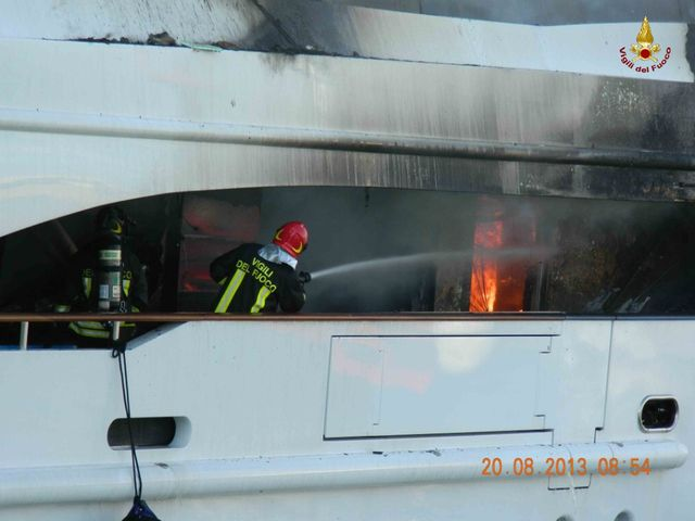 Firefighters extinguishing the fire on board 56m Benetti Motor Yacht FB261