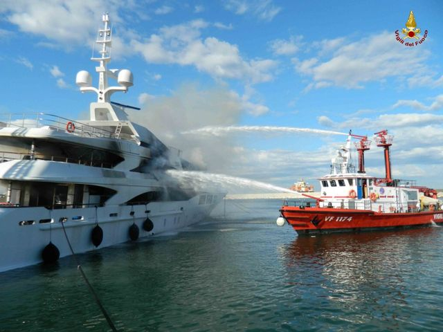 Firefighters extinguishing fire aboard FB261 superyacht by Benetti