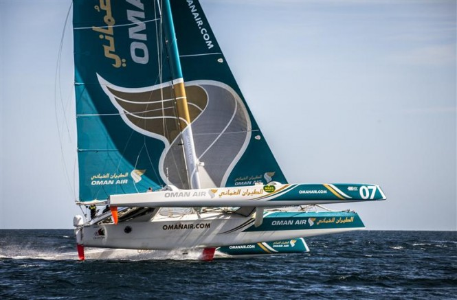 Oman Air Musadam flies two hulls on approach to the Fastnet Rock - Photo by Rolex Daniel Forster
