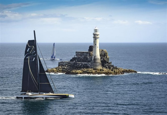 Superyacht Spindrift 2 just ahead of Banque Populaire yacht as she passes the Fastnet Rock on Monday afternoon - Photo by Rolex Kurt Arrigo