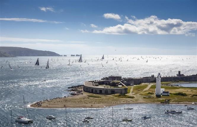 The 2013 Rolex Fastnet fleet leaving the Solent - Photo by Rolex Kurt Arrigo