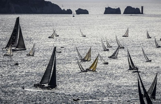 The Rolex Fastnet Race 2013 record breaking fleet passing by The Needles - Photo by Rolex Kurt Arrigo