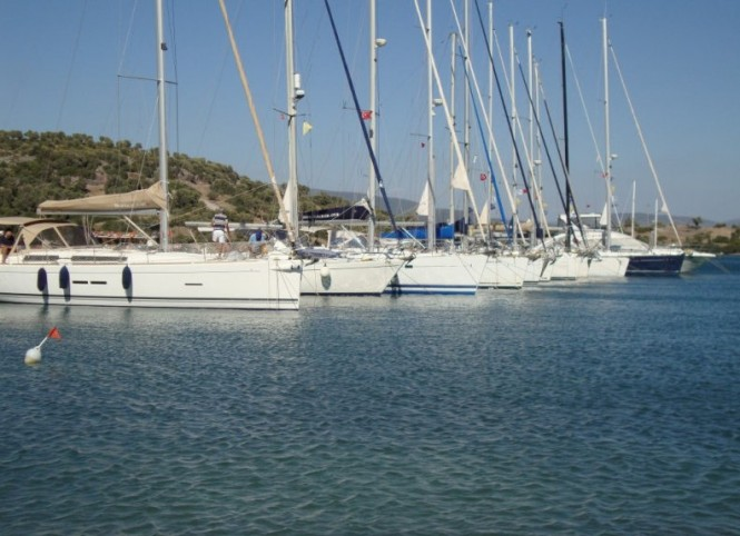 First luxury yachts anchored at Port Iasos Marina
