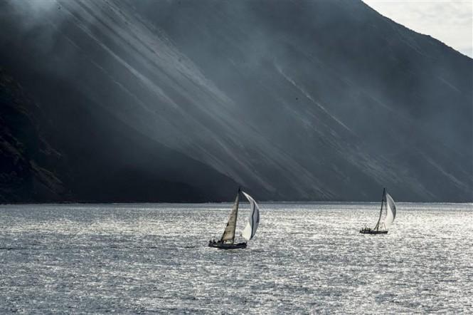 Fleet sailing close to the Stromboli shore - Photo by Rolex Kurt Arrigo