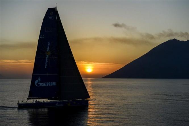 Superyacht Esimit Europa 2 approaching Stromboli at sunset