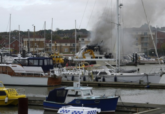 The burning Kahu Yacht at East Cowes. Credit George Chastney. Photo courtesy of Cowes Harbour Commission