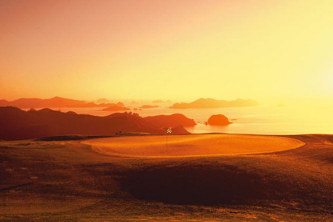 Golf Green with Cavallis Sunrise - Image credit Kauri Cliffs
