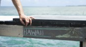 Hands rest on dock - Oahu Island - Photo Hawaii Tourism Authority - Daeja Faris