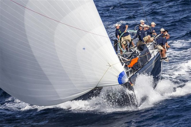 Hap Fauth at the helm of Bella Mente - Credit: Rolex/Carlo Borlenghi