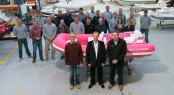 Mathew Hornsby John Chartres and James Barke with the Breast Cancer Care yacht tender and Williams factory staff