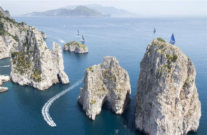 Capri's dramatic Faraglioni with the mainland in the distance. Photo by Rolex Carlo Borlenghi