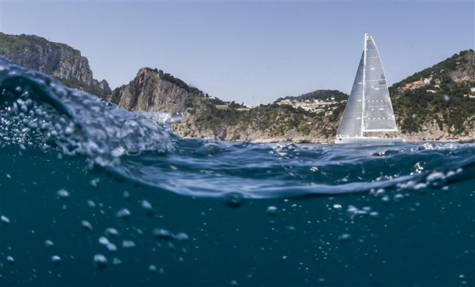 Enrico Gorziglia's Brenta 60 Yacht Good Job Guys made great gains under Capri's dramatic cliffs. Photo by Rolex Carlo Borlenghi