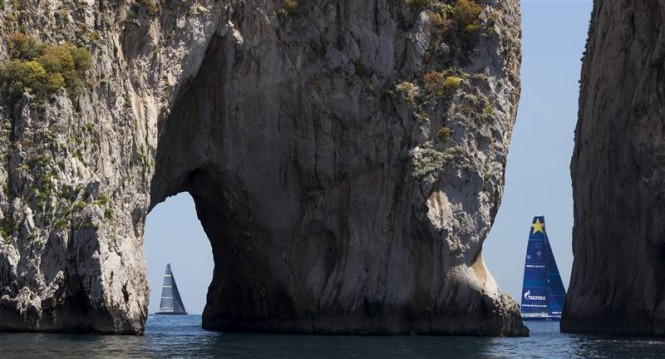Esimit Europa 2 yacht was first to pass the famous Faraglioni Islands. Photo by Rolex Carlo Borlenghi