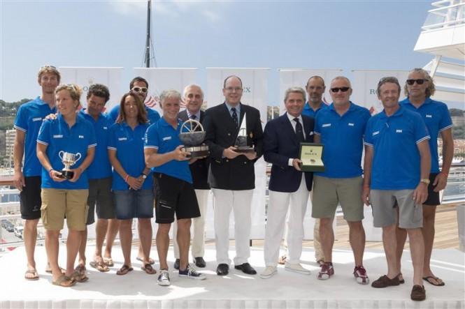 HSH Prince Albert II of Monaco, Gian Riccardo Marini and the TIXWAVE (GBR) team, overall winner of the 62nd Giraglia Rolex Cup - Photo by Rolex Carlo Borlenghi