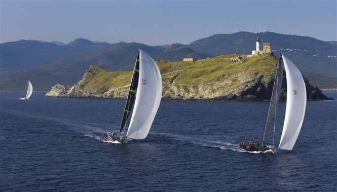 Mini Maxis JETHOU (GBR), STIG (ITA) and ALEGRE (GBR) reach the Giraglia rock at daybreak in the 2013 race - Image by Rolex Carlo Borlenghi
