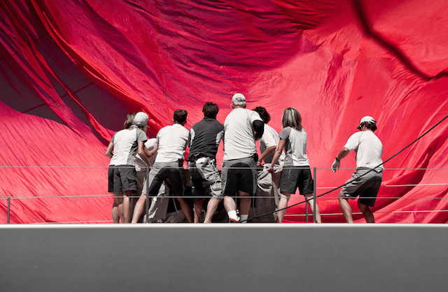The crew of Ghost tirelessly pack their kite at the end of the final run Jeff Brown | Superyacht Media