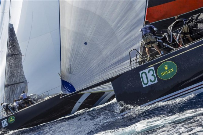 BELLA MENTE and STIG drop their headsails as they fly downwind - Image by Rolex Carlo Borlenghi