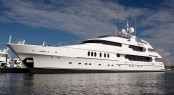 Luxury motor yacht anchored in the beautiful Singapore yacht holiday location