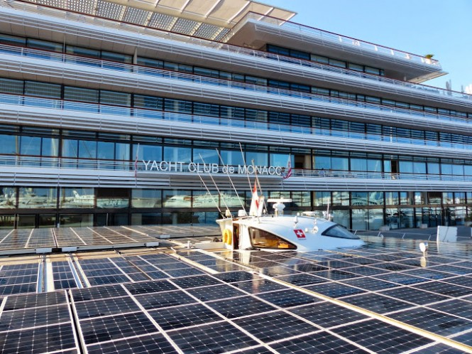 PlanetSolar in front of Yacht Club de Monaco