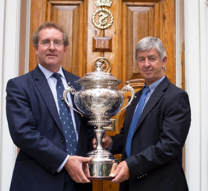 (left to right) RORC Commodore, Mike Greville & Chief Executive, Eddie Warden Owen with the  magnificent antique 1928 RORC Transatlantic Race Trophy for the Overall Winner in IRC  Credit: RORC/onEdition